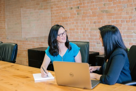 Woman supporting team member in workplace